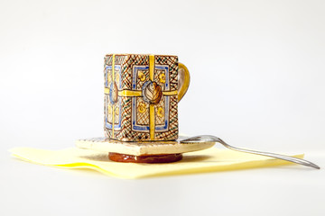 Ceramic coffee cup with a square saucer