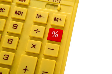 yellow calculator with red button on with background