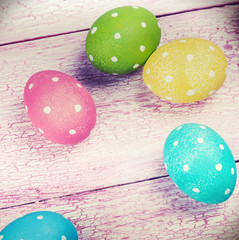 colored Easter eggs on wooden