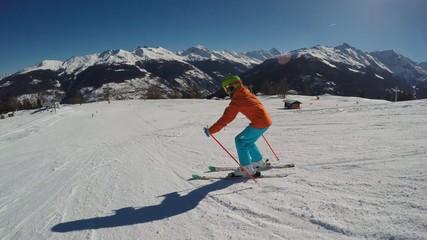Ski vacation - girl skiing down, fun on mountainside
