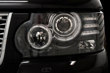 Black car headlights. Exterior detail.