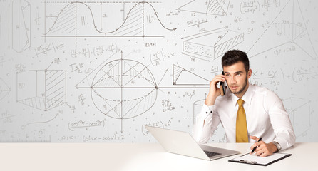 Businessman with business calculations background