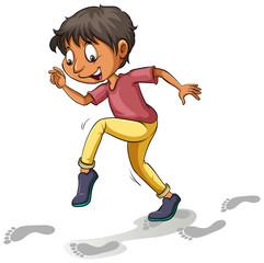 A boy following the footprints