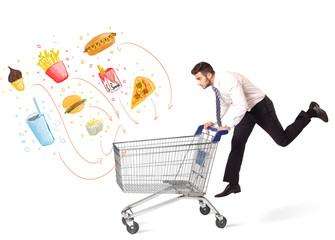Man with shopping cart with toxic junk food