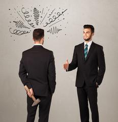 Angry business handshake concept