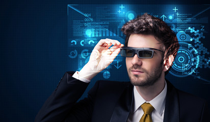 Young man looking with futuristic smart high tech glasses