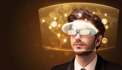 Young man looking at futuristic social network map