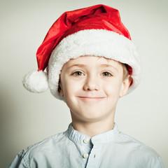 Little boy in Santa Claus hat