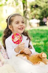 happy little girl with lollipop