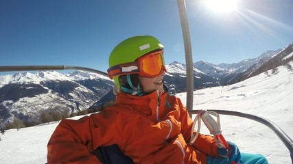 Skiing - young girl on ski lift