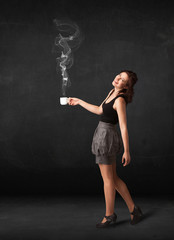 Businesswoman holding a white steamy cup