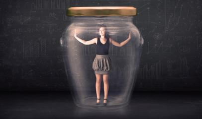 Businesswoman shut inside a glass jar concept