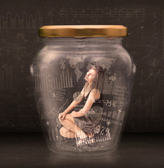 Businesswoman traped in jar with graph chart symbols concept
