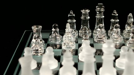 4K. Hand making a winning chess move  isolated on black