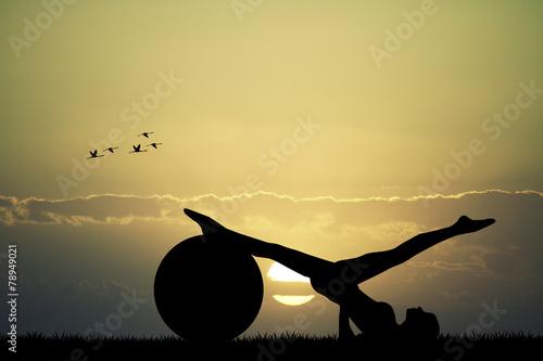 Fototapeta Pilates silhouette at sunset