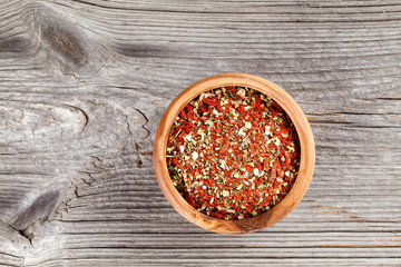 Dry spices. colour dried Italian spice for pasta, on a wooden ba