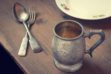 Silver tableware on a wooden table