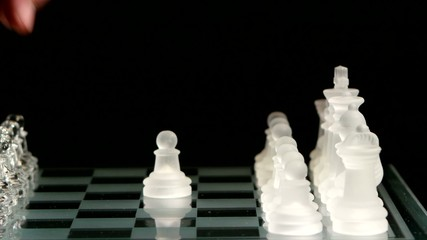 4K. Pawn move on the chessboard. black background.