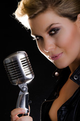 Portrait of female rocksinger with microphone