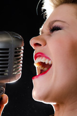 Rock and roll singer with retro microphone