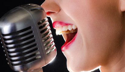 Hot red lips and a silver retro microphone