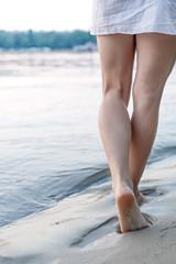 woman walking on sand beach