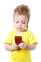 funny baby looks at the screen of the smartphone