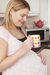 Pregnant Woman Relaxing With Hot Drink