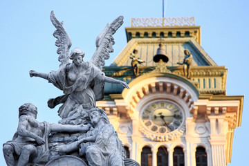 DETAIL OF STATUES TO uNITà SQUARE WITH TrIESTE TOWEN HALL IN THE