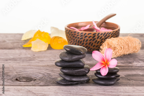 Foto op Canvas Frangipani Spa with black stones, seashell shaped soaps and loofah