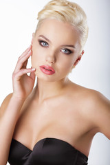 Young Blond Touching her Face with Clean Healthy Skin