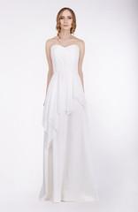 Fashion Model Standing in Long White Dress
