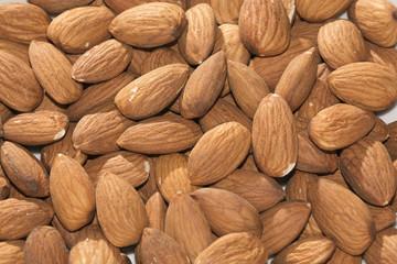 Shelled almonds closeup, background