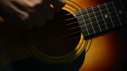Accoustic Guitar Strumming Close Up