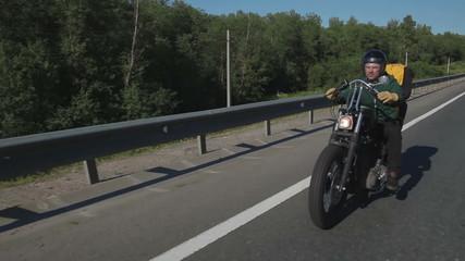 Motorcyclist posing on camera