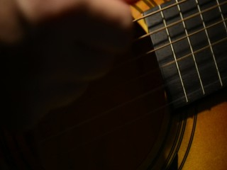 Acoustic Guitar Strumming Close Up