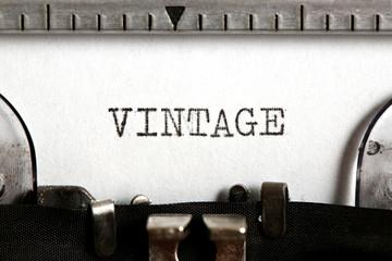 Word VINTAGE written on an old typewriter