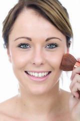 Attractive Young Woman Applying Face Powder