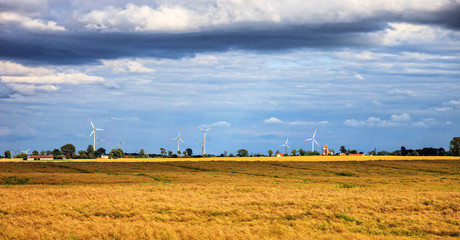 Rural landscape with wind turbine towers.