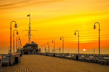 Sunrise at the wooden pier in Sopot, Poland.
