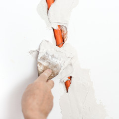 Plastering Flexible Corrugated Cable Duct into the wall
