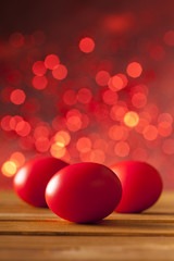 Three Easter eggs on red background