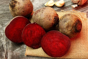 red beets on a wooden background
