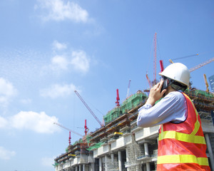 Construction worker talking on a smart phone