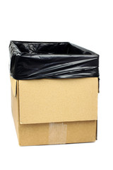 homemade trashcan made of a cardboard box with plastic bag in it