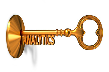 Analitics - Golden Key is Inserted into the Keyhole.