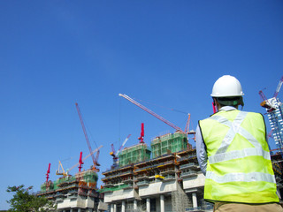 Construction worker looking at a building