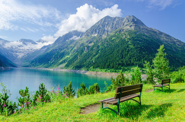 Empty bench in front of the azure mountain lake, Zillertal, Alps