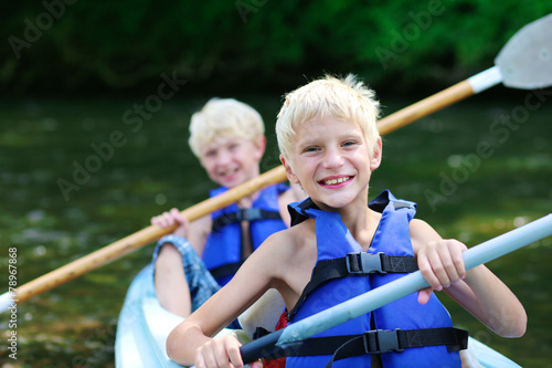 Foto op Aluminium Kamperen Two brothers kayaking on the river