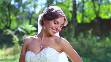 Bride in wedding day in the petals of flowers.